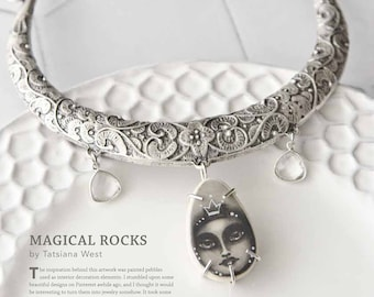 Famous Pebble Necklace published in Jewelry Affaire magazine with crowned moon goddess, rustic floral collar, and faceted crystal charms.