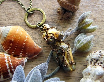 """Wire wrapped necklace """"Goddess"""" with amazing lampwork female body miniature on a hammered ring. Custom length chain."""