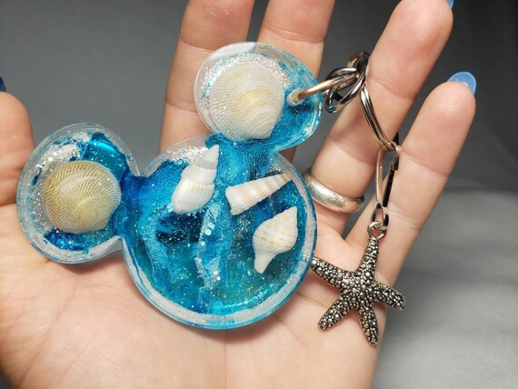 Mermaid Under the Sea Mouse Ears Resin Keychain with Sparkles Blue and Silver Starfish Charm