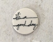 It's a good day magnet. 1.5 inches. Super strong magnet.