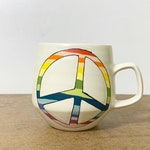 11. White Rainbow Peace Mug. 16 oz.