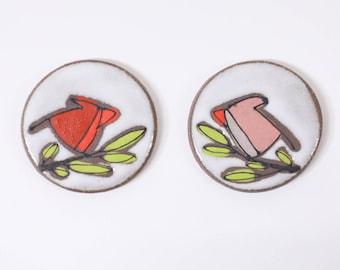 33. Pair of Cardinal Magnets.