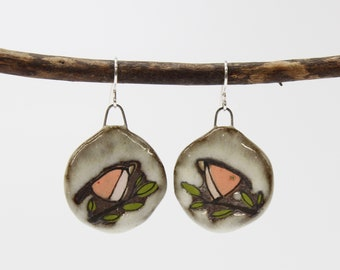 "64. Pink Bird Disk Earrings with Toast Glaze. Sterling Silver Hooks. 1 3/4""h x 1""w"