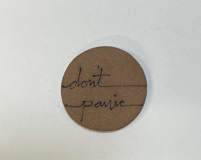 81. Don't Panic Magnet.