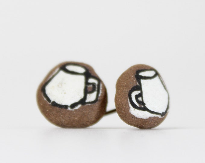 """36. White Muggie Stud Earrings. Stainless steel stud with stabilizer backs. 1/2"""""""