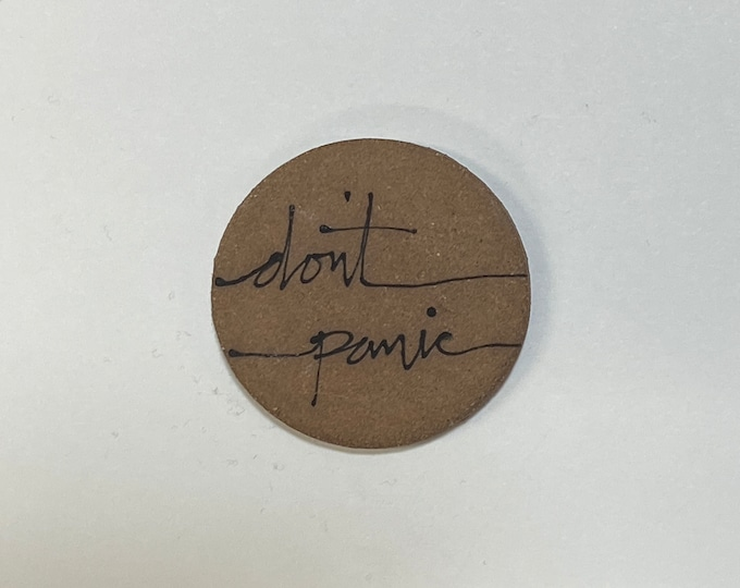 80. Don't Panic Magnet.