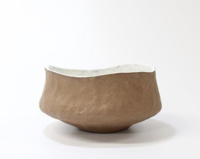 "18. Hand Built Bowl with White Glaze Inside. Unglazed Outside. 3.5"" x 6.75"""