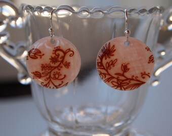 pale pink circle earrings with brown floral design