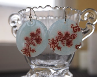 pale turquoise circle earrings with brown floral design