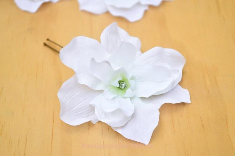A set of 3 White Delphinium U Pins