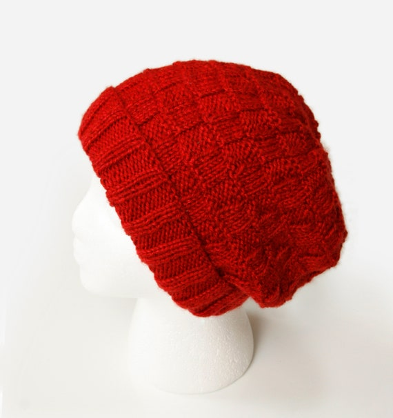 b6551fccb3295 Red hand-knit winter hat with rectangular stitch design for