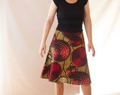 The item on the photo is sold. Ask us for new patterns for the African wax print A-Line skirt.