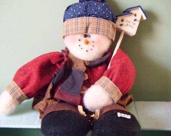 Snowman doll with birdhouse