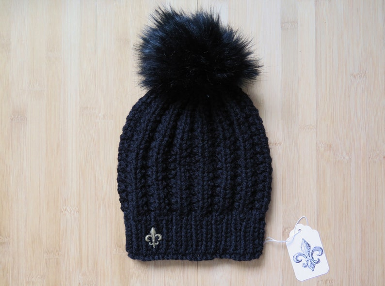 2c1390d761388 Knitted black hat with faux fur pom pom for women