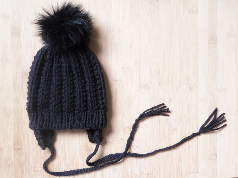 a0e78fca645df Baby flap hat with faux fur pompom Knitted hat with ear