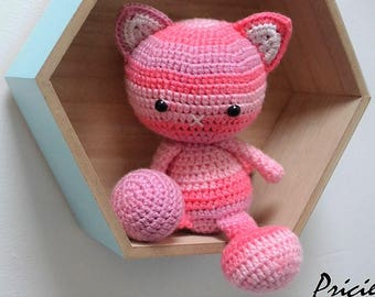 Amigurumi, plush cat with crochet hook of pink and pale pink