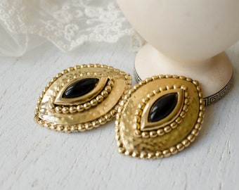 Huge gold tone vintage clip-on earrings  with black glass cabochon, Tribal large clip on earrings
