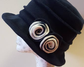 Handmade Navy Blue Fleece Hat With Cosy Fleece Lining and Navy and Cream Flowers