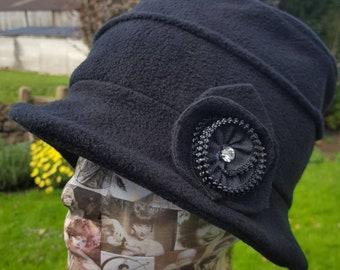 Cosy Black Fleece Hat with Zip Flower detail and Fleece Lining