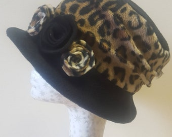 Handmade Black  and Leopard Print Fleece Hat With Cosy Fleece Lining and Fleece Flowers