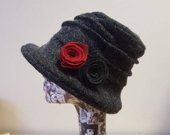 Black Felted Wool Cloche Hat with Black and Red Flower Detail.
