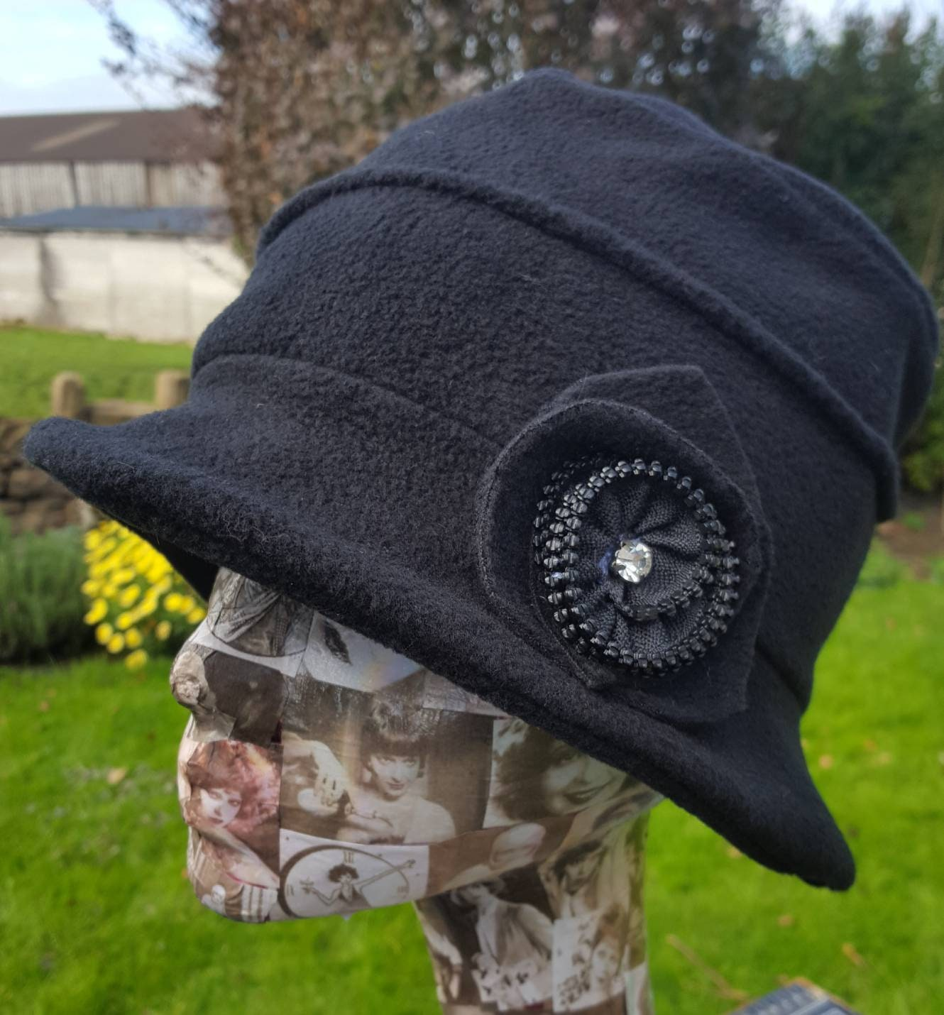 274d78fc3db Cosy Black Fleece Hat with Zip Flower detail and Fleece Lining