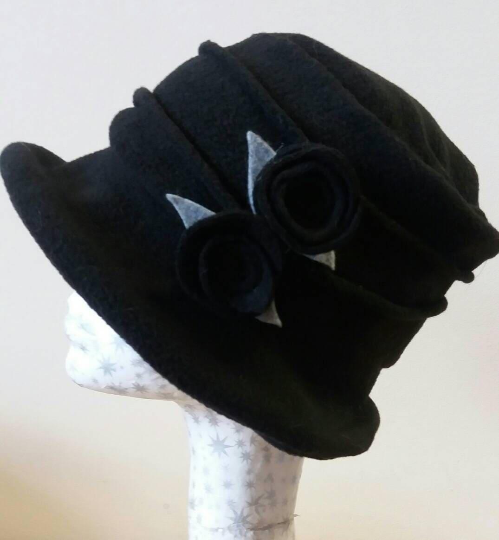 73e652e05df Black Fleece Cloche Hat with Black Flower Detail.