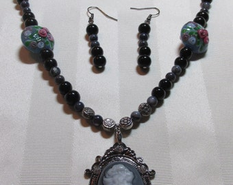 Black and Grey Round beads/Clear Flowery Round Beads with a Cameo Pendant Necklace and Earring Set (N246)