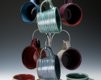 Set of 4 wheel-thrown pottery espresso cups in a variety of shapes. Each one is unique