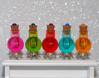 set of 5 acrylic potion bottles with corks, matching rhinestone and metal crown base