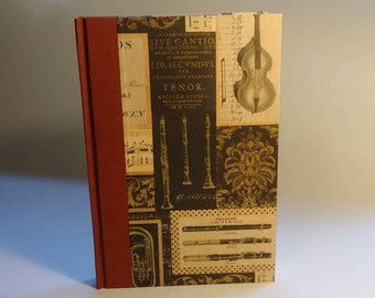 Lined journal with classic music theme paper cover.