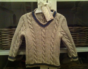 Cable knit cricket style jumper. Sizes available 0-6m 6-12m 1-2years 3-4years
