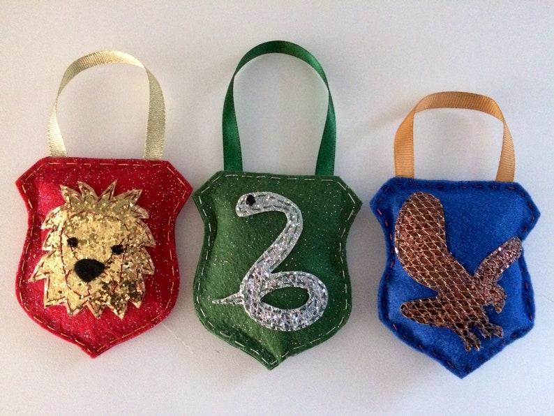 Felt sparkly stuffed house crest ornaments eagle snake lion badger