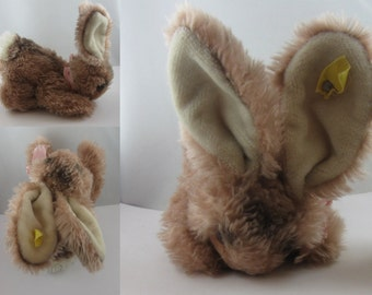 Original STEIFF soft toy / plush toy HARE / RABBIT. With button and completely faded flag. Made in Germany. 1970s. Vintage toy collectible