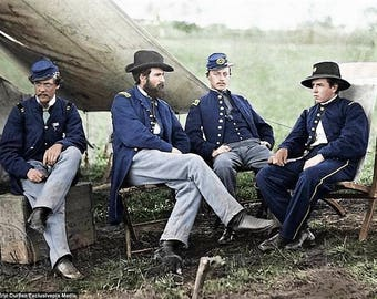 Captain Pierce, Captain Page, Captain Howell and Lieutenant Kelly sitting on wooden boxes 1863