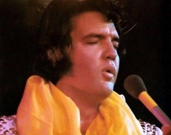 Elvis Presley in a great color photo taken on stage