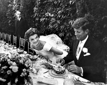 John F. Kennedy and his bride, at their wedding reception in 1953