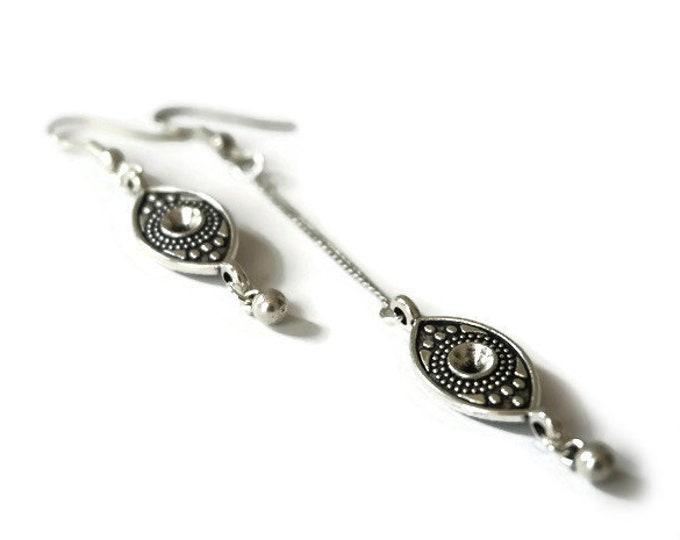Doli asymmetric earrings.