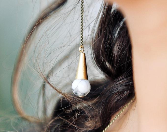 Klowas asymmetric earrings.