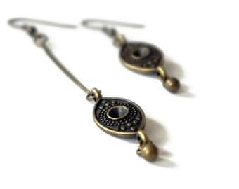 Doli asymmetrical bronze earrings.