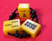 Chinese Bakelite amber resin thick MAH JONGG tile bracelet. Three chunky 30s vintage mango tiles. Black glass, round and faceted beads.