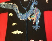 Dramatic Storybook Knits handmade Mah Jongg sweater. Jewel tones. Features dragon design. Faceted red bead eyes. Gold threads. Size S