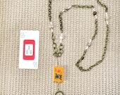 Eyeglass Chain or Necklace with vintage MAH JONGG Bakelite 3 flower tile. Jasper, Czech glass shell seed beads. Brass chain links. 3 Bam