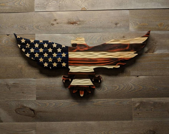 Carved wooden American flag eagle with unique chisel texture.