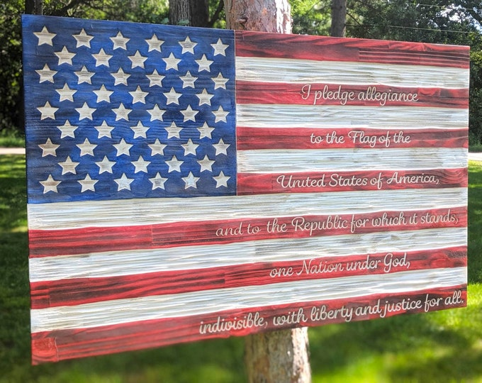 Pledge of Allegiance Flag carved in wood distressed Red, White and Blue colors with unique chisel texture. Rustic flag.