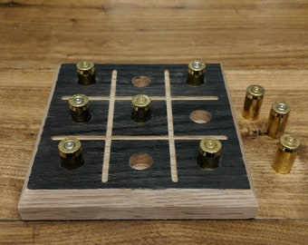 Tic Tac Toe board game great for 2 player fun. Tic-Tac-Toe peg game with ammo casing pegs