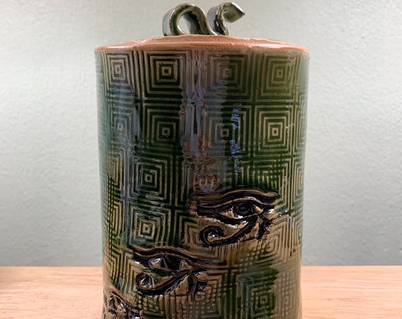 Ceramic Jar with Lid in Rich Green with Eye of Horus and Geometrical Patterned Background