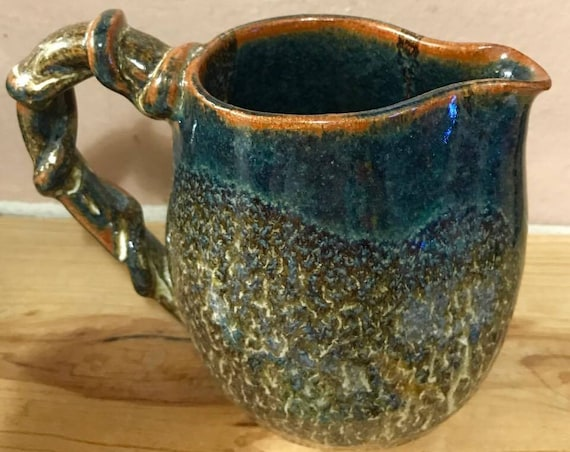 Charming Pitcher with Twined Handle in Layered Earth Tones