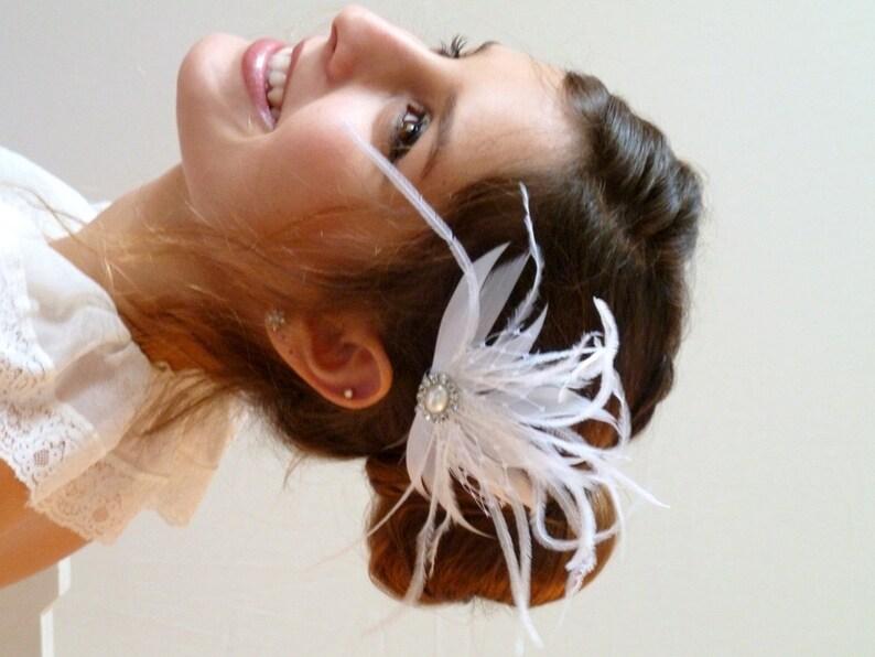 7c77152177 Francés de novia pedazo de cabeza de pluma con malla velo