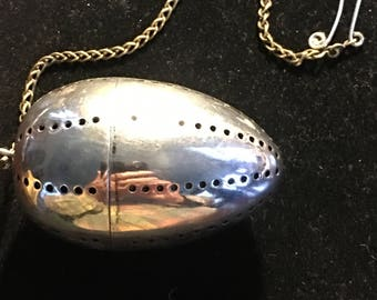 Tea Ball,Tea Infuser in silver-plate and egg shaped with no markings,circa 1940